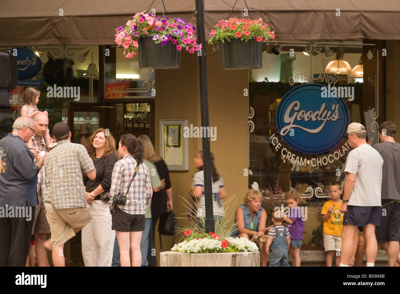 Friends families neighbors socializing at First Friday Gallery Walk Bend, Oregon - Stock Image