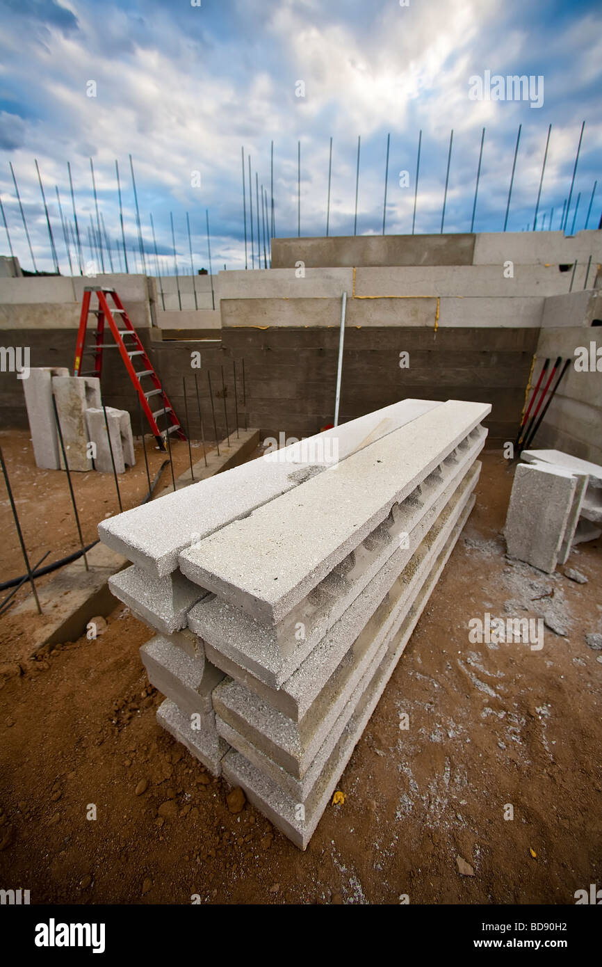 Recycled styrofoam and light wight concrete make up these building materials as block walls rise and a new home - Stock Image