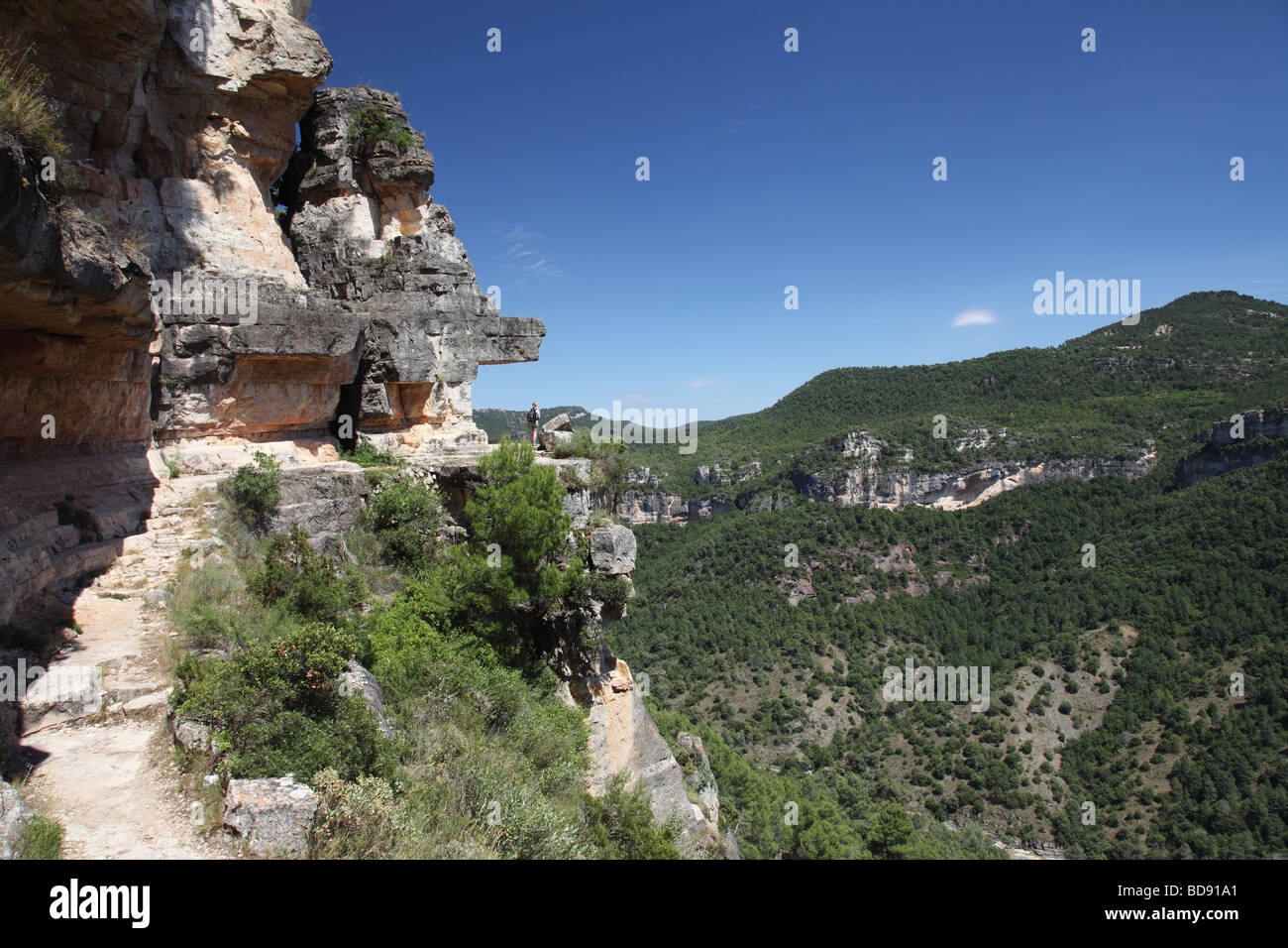 Hill Walker on Exposed Path La Trona Siurana Priorat Region Tarragona Province Catalonia Spain - Stock Image