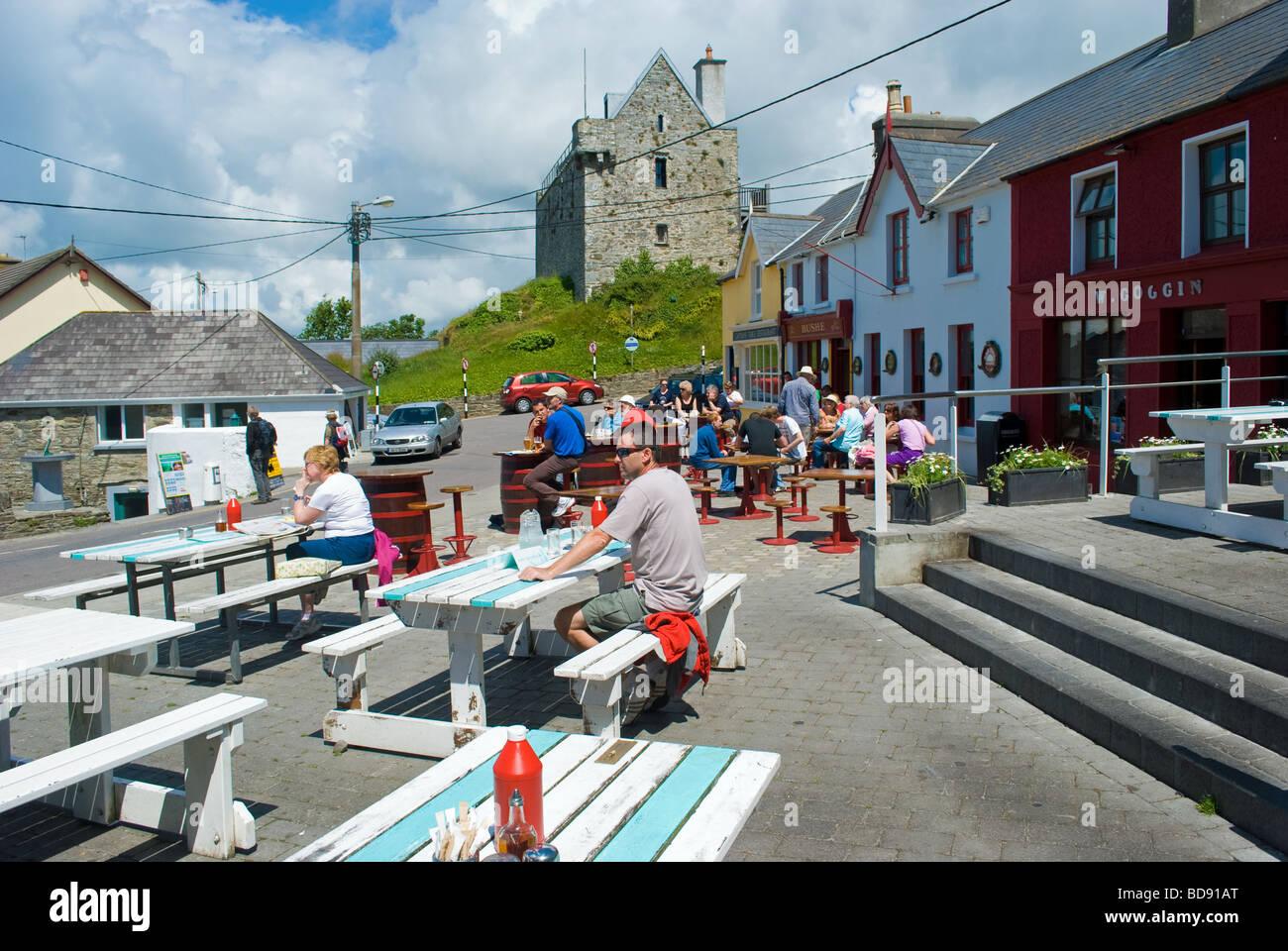 Tourists enjoy summer weather in Baltimore, West Cork, Ireland - Stock Image