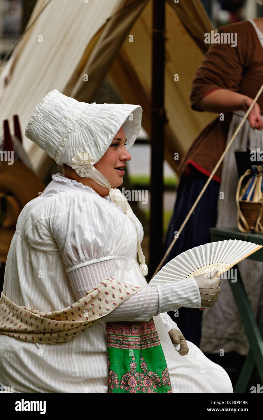 Woman in Early Nineteenth Century Costume Sitting at Encampment at Reenactment in Corydon Indiana - Stock Image