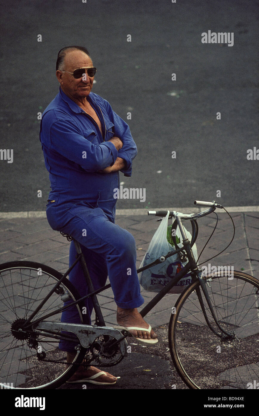 Man with bicycle Nice France - Stock Image