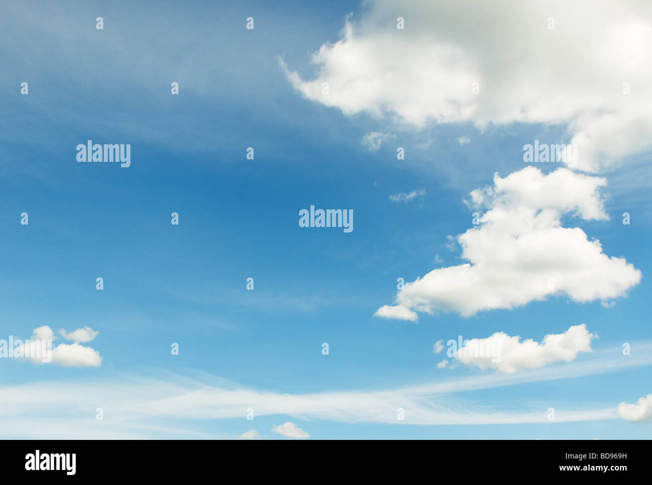 white clouds over deep blue sky background - Stock Image