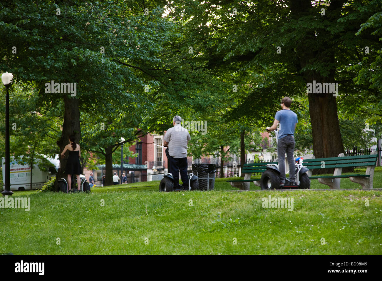 Two wheel ELECTRIC SCOOTERS on a pathway in the BOSTON COMMON BOSTON MASSACHUSETTS - Stock Image