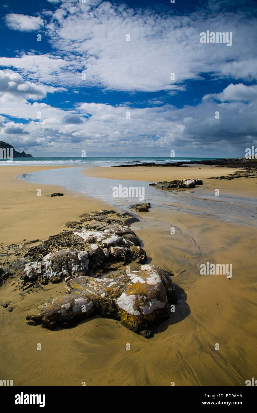 New Zealand Otago The Catlins Sandy beach and rocky outcrops of Purakaunui Bay Stock Photo