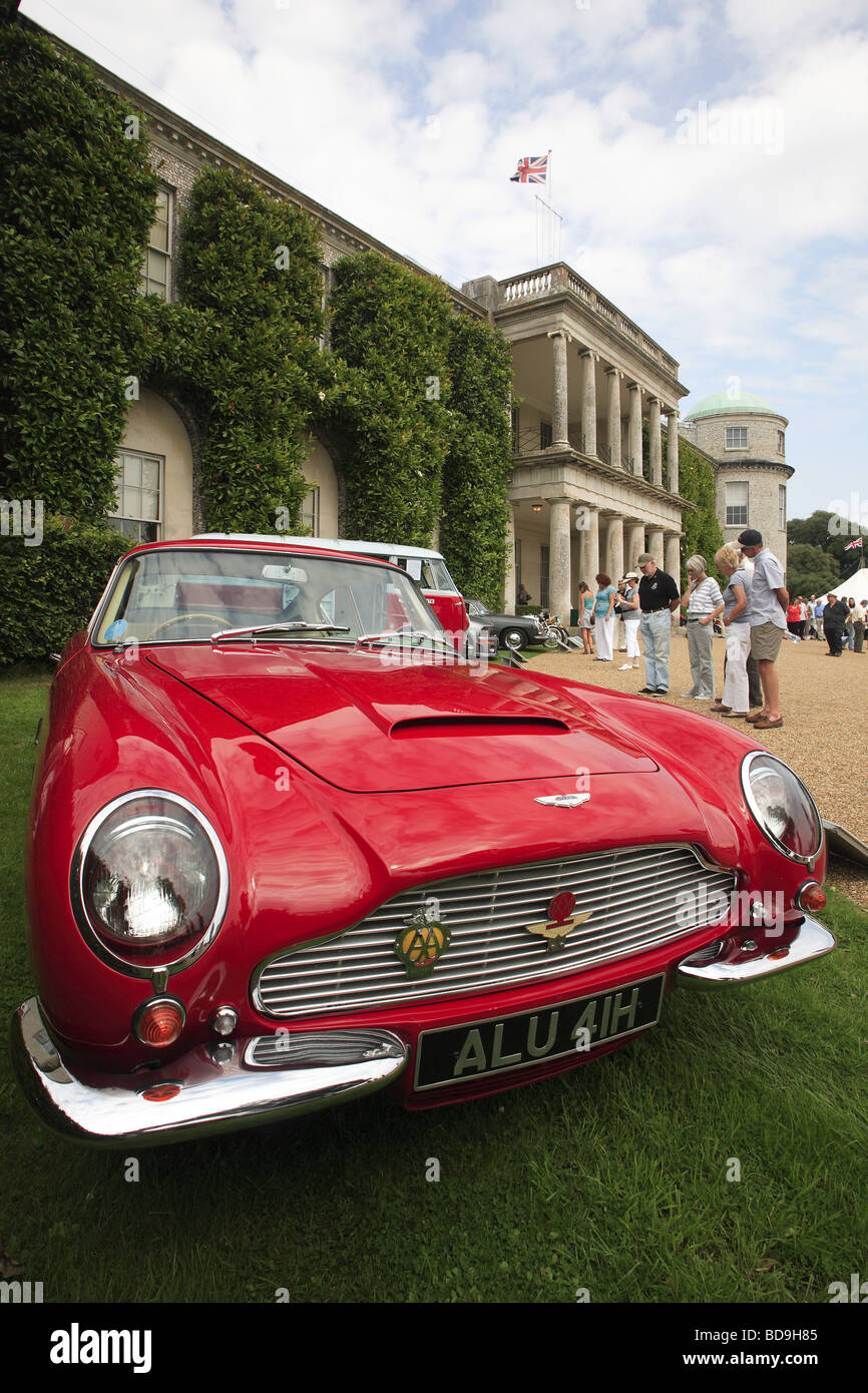 1989 red Aston Martin parked in front of Goodwood House, West Sussex, England, UK - Stock Image