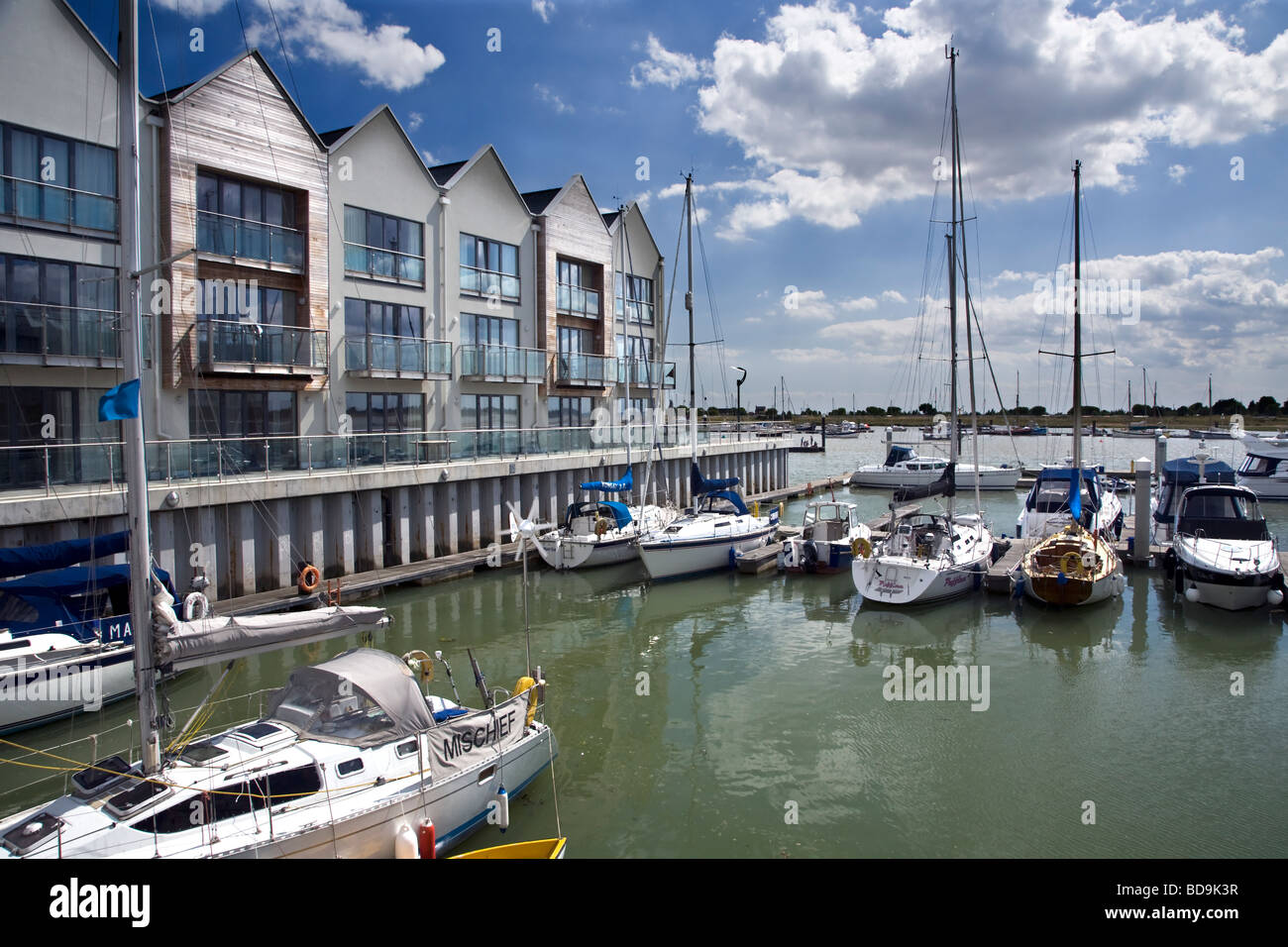 Wonderful BOATS MOORED AT THE NEW WATERSIDE MARINA APARTMENTS AT BRIGHTLINGSEA NEAR  COLCHESTER, A SMALL POPULAR SEASIDE TOWN.