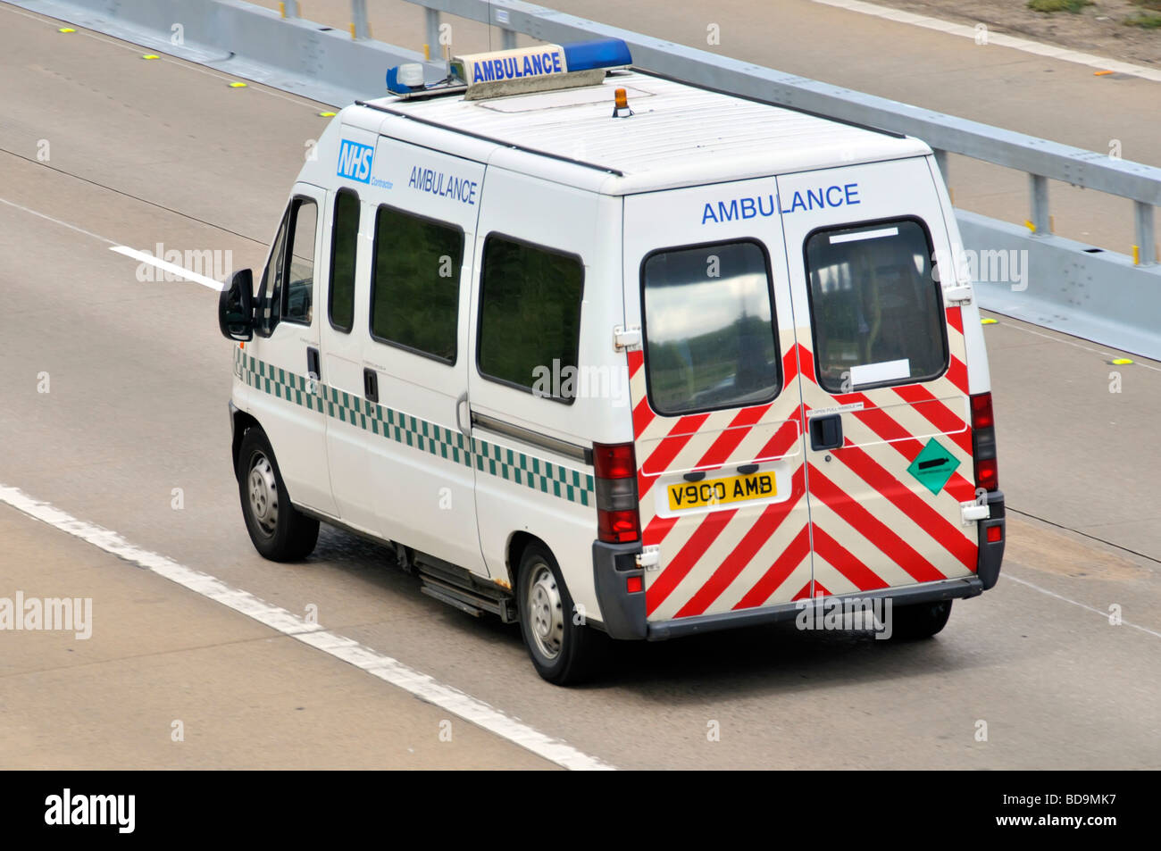 NHS contractor Ambulance service vehicle at speed  on M25 motorway - Stock Image