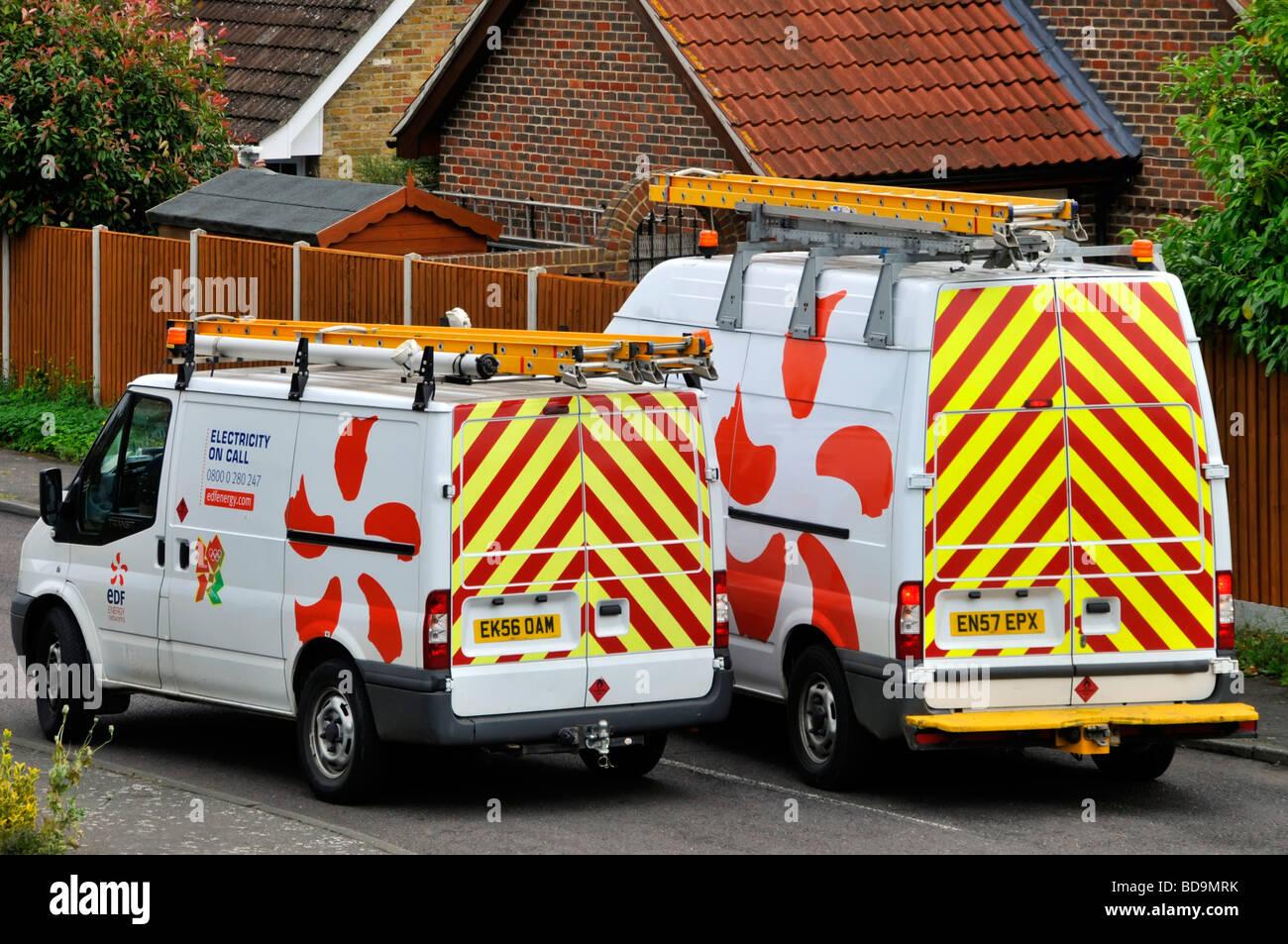 EDF Electricity on call engineers vans in residential street - Stock Image