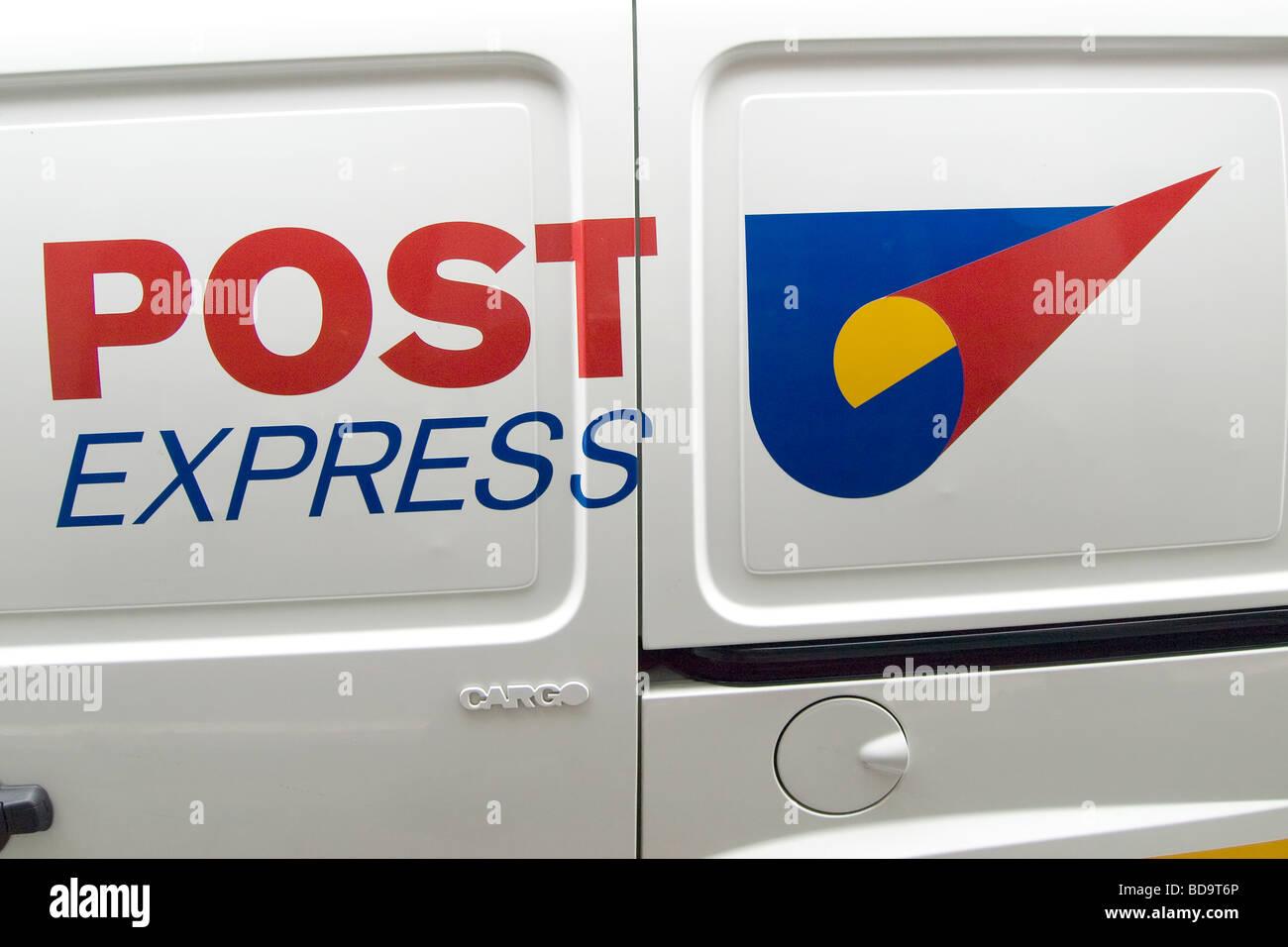 Post Express logo on a Guernsey Postal Service van - Stock Image