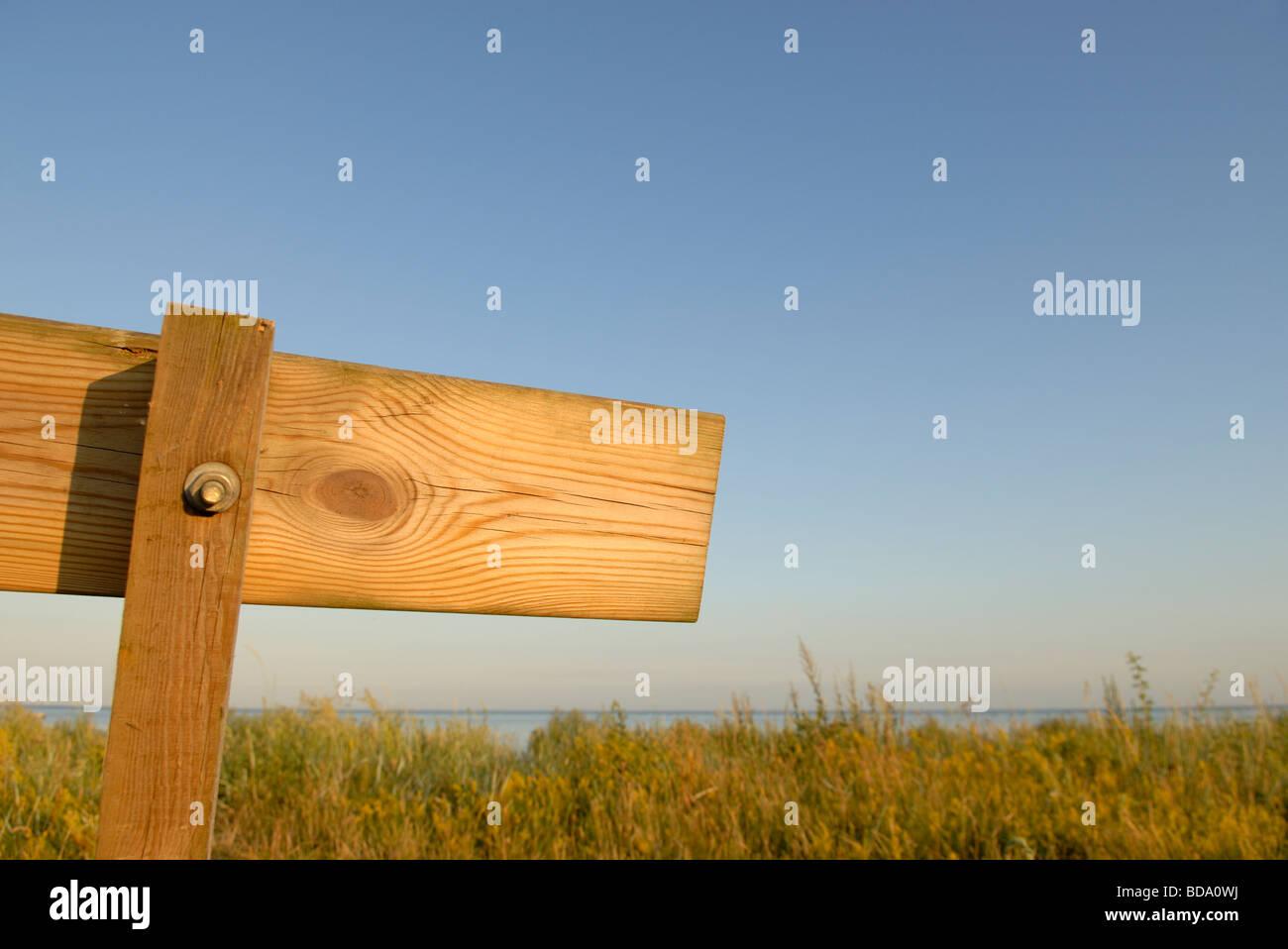 COASTAL LANDSCAPE BEHIND BENCH - Stock Image