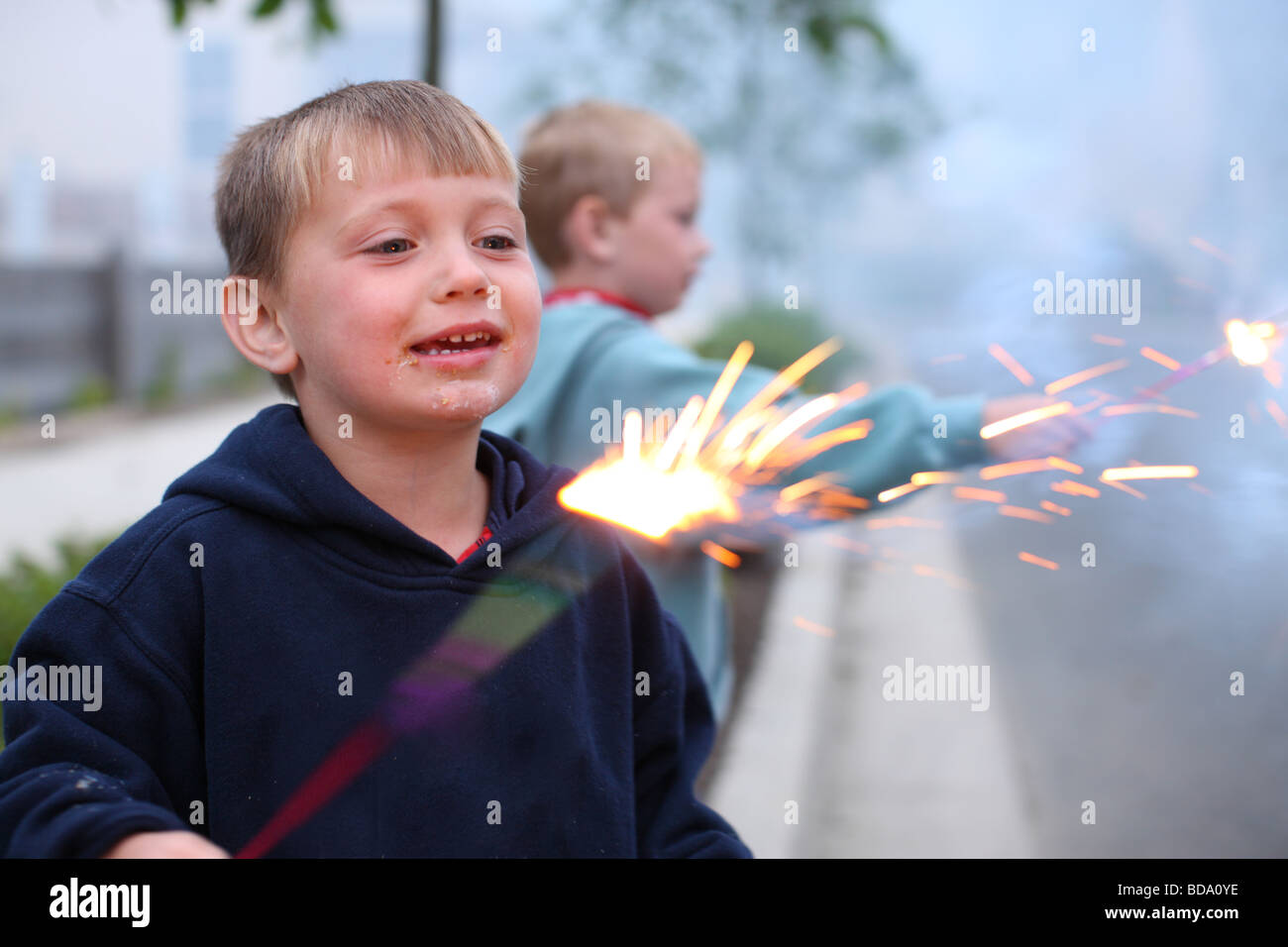 Two young boys with 4th of July sparklers - Stock Image