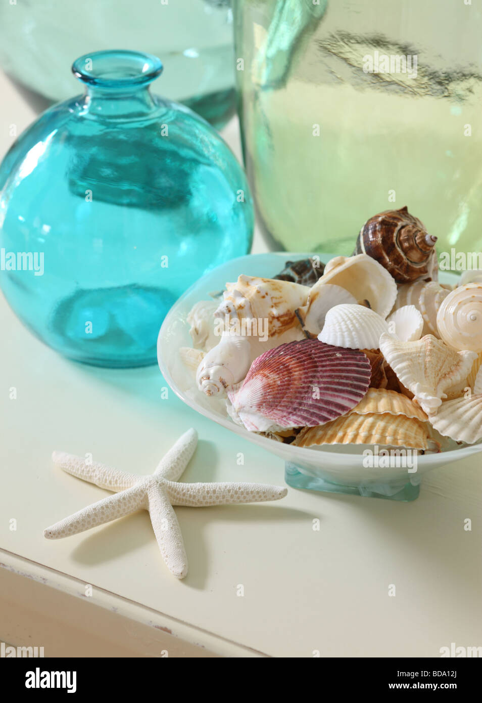 Shells and colorful glass - Stock Image