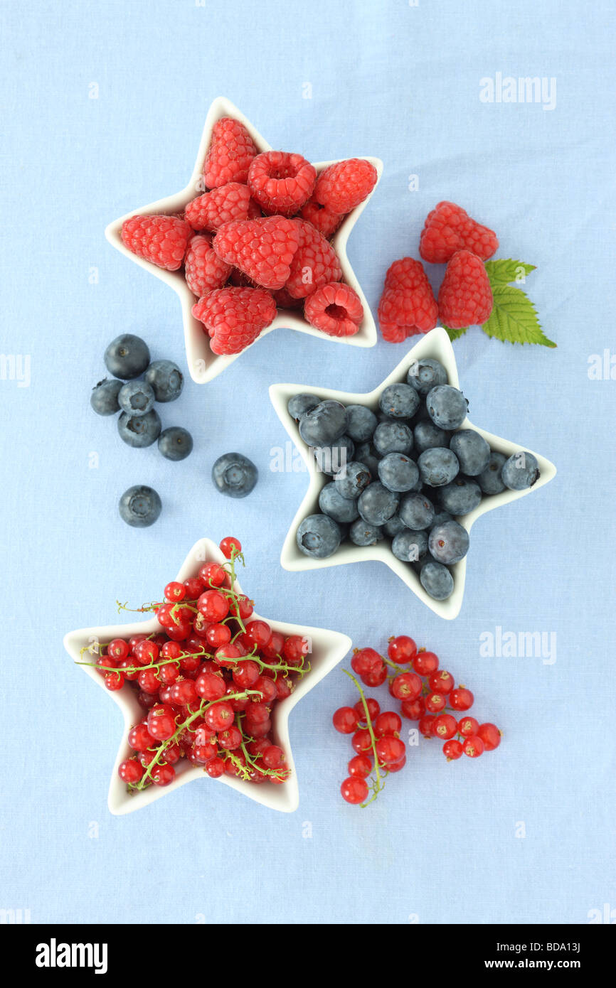 Berries in star shaped bowls - Stock Image