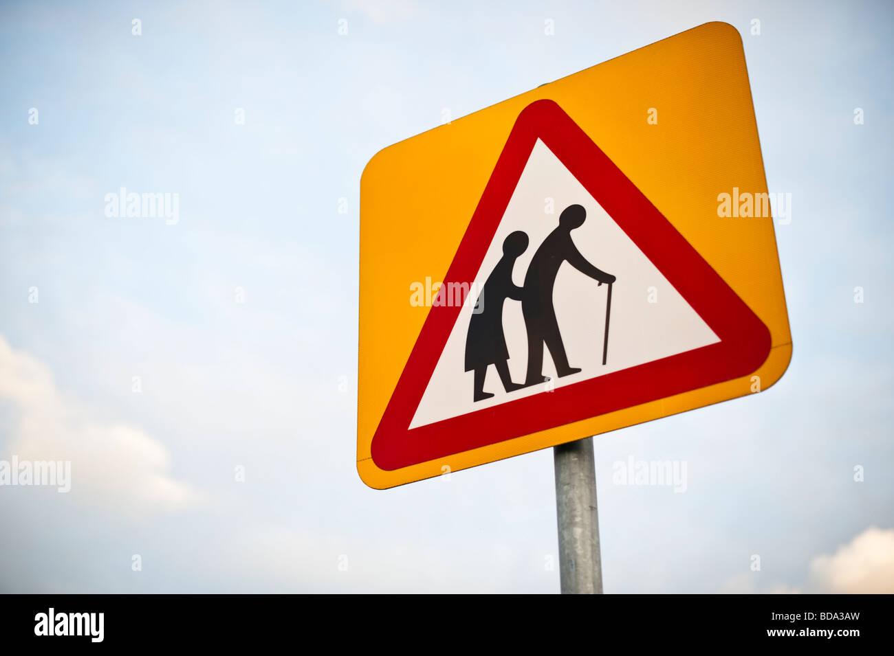 Elderly People road sign warning triangle UK - Stock Image