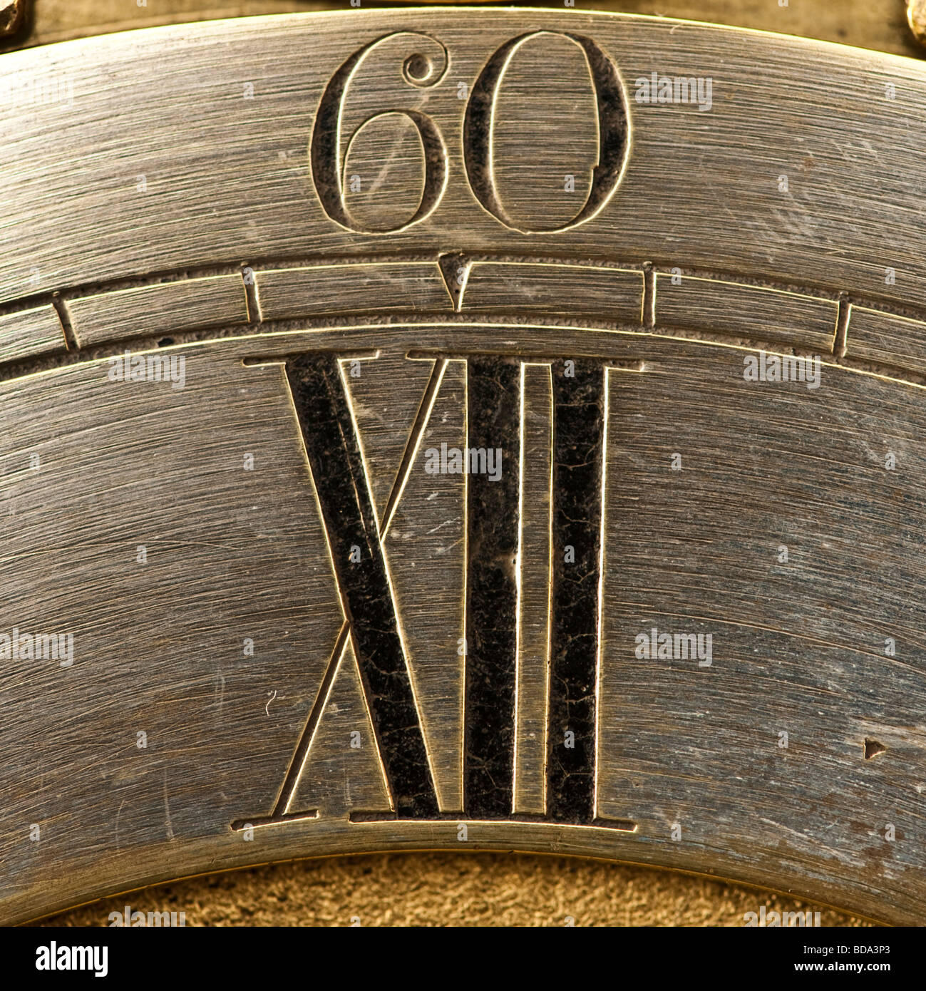 old antique clock face showing 60 and XII - Stock Image