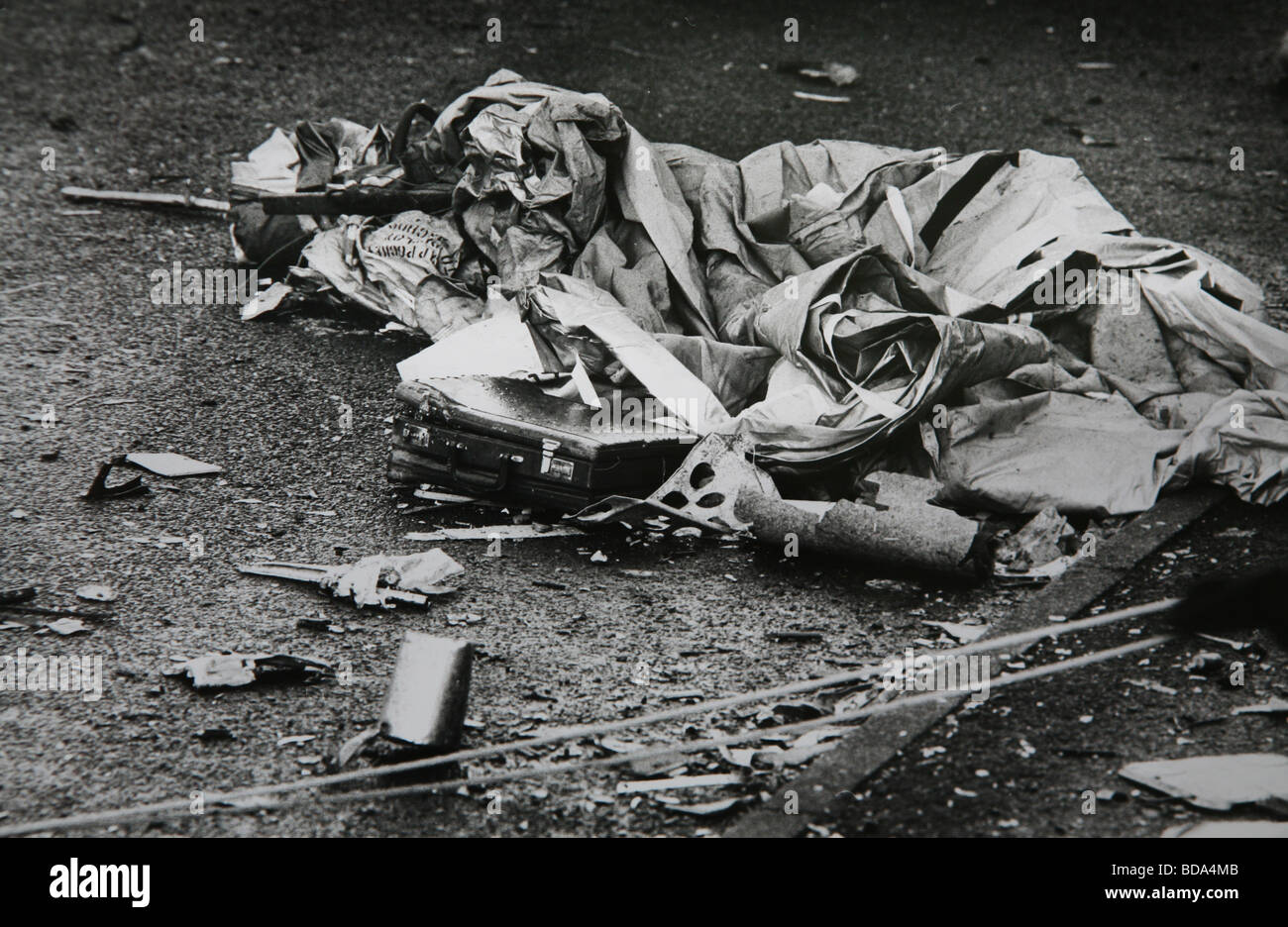 A briefcase and other debris lay on the ground in Lockerbie after Pan Am flight 103 crashed in the Scottish town - Stock Image