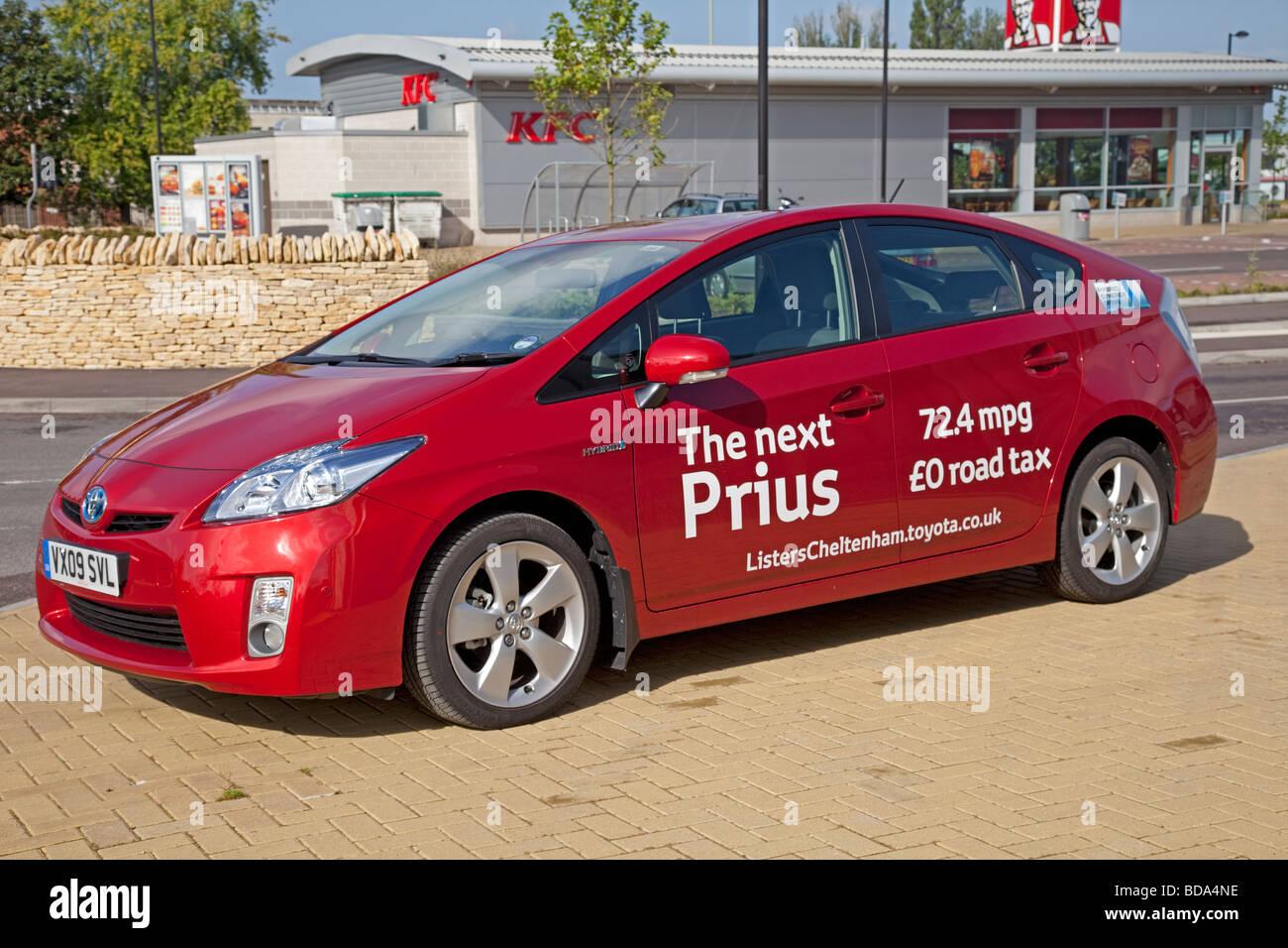 New Prius T3 hybrid red motor car August 2009 parked outside Homebase in Cheltenham - Stock Image