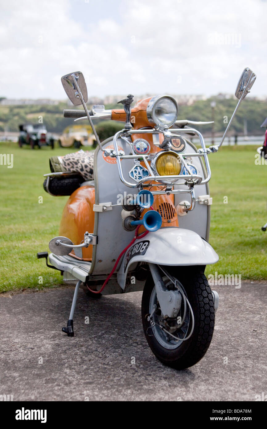 Original orange and Grey Lambretta 1960's motor cycle in show with Chromes, Klaxon, mirrors headlights. 96823 - Stock Image