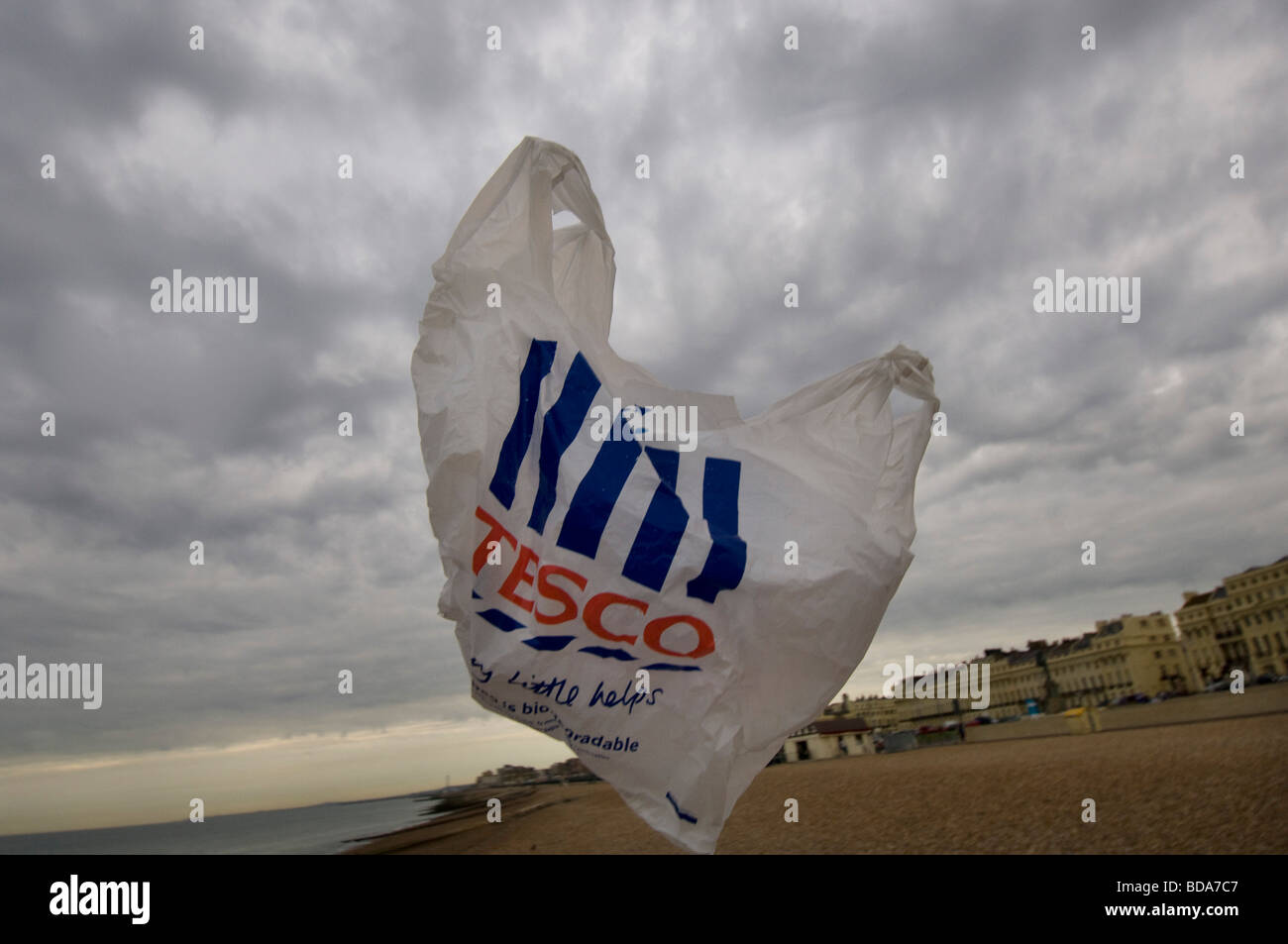 A tesco supermarket plastic bag blown in the wind on a beach - Stock Image