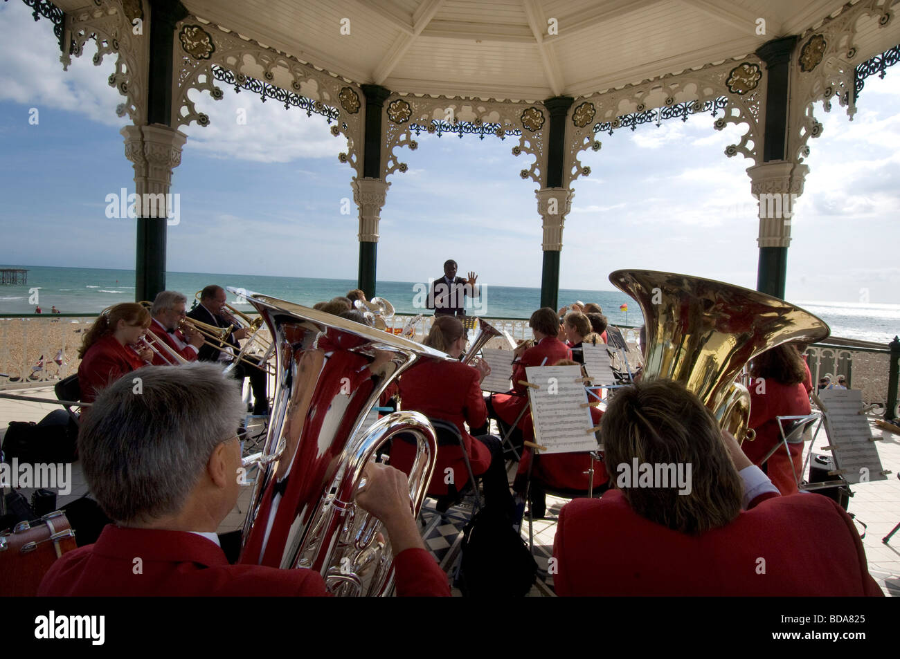 A brass band giving a concert on Brighton bandstand with the sea in the background. Stock Photo