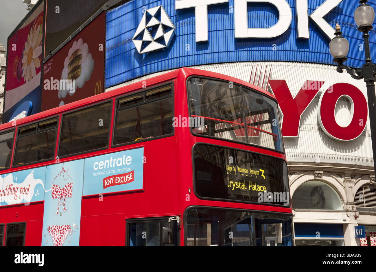 Close up of No 3 red double decker  London bus in front of advertising hoardings in Picadilly, London UK capital - Stock Image