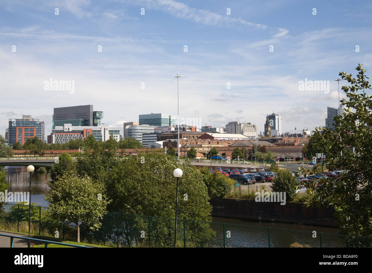 Manchester England UK View across River Irwell to tall buildings of city centre skyline - Stock Image