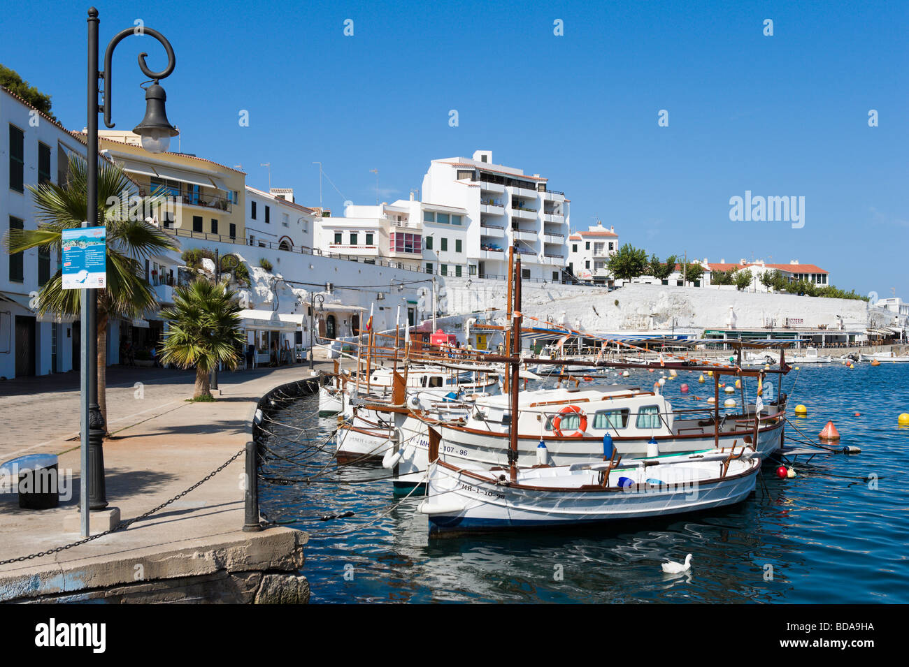 Traditional fishing boats in Moll de Cales Fonts harbour, Es Castell, near Mahon, Menorca, Balearic Islands, Spain - Stock Image
