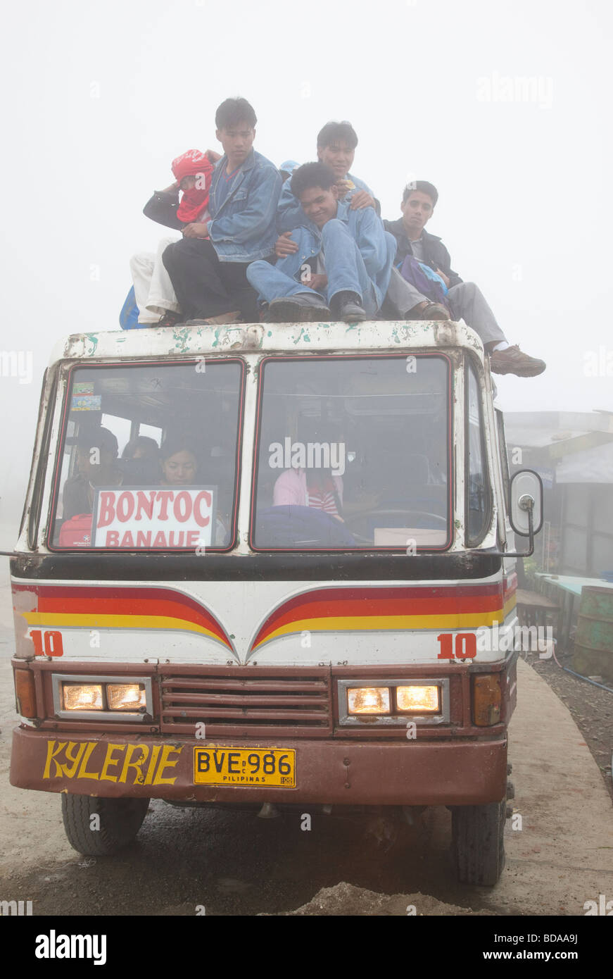 Filipinos on bus roof journey from Banaue and Bontoc Northern Luzon Philippines - Stock Image