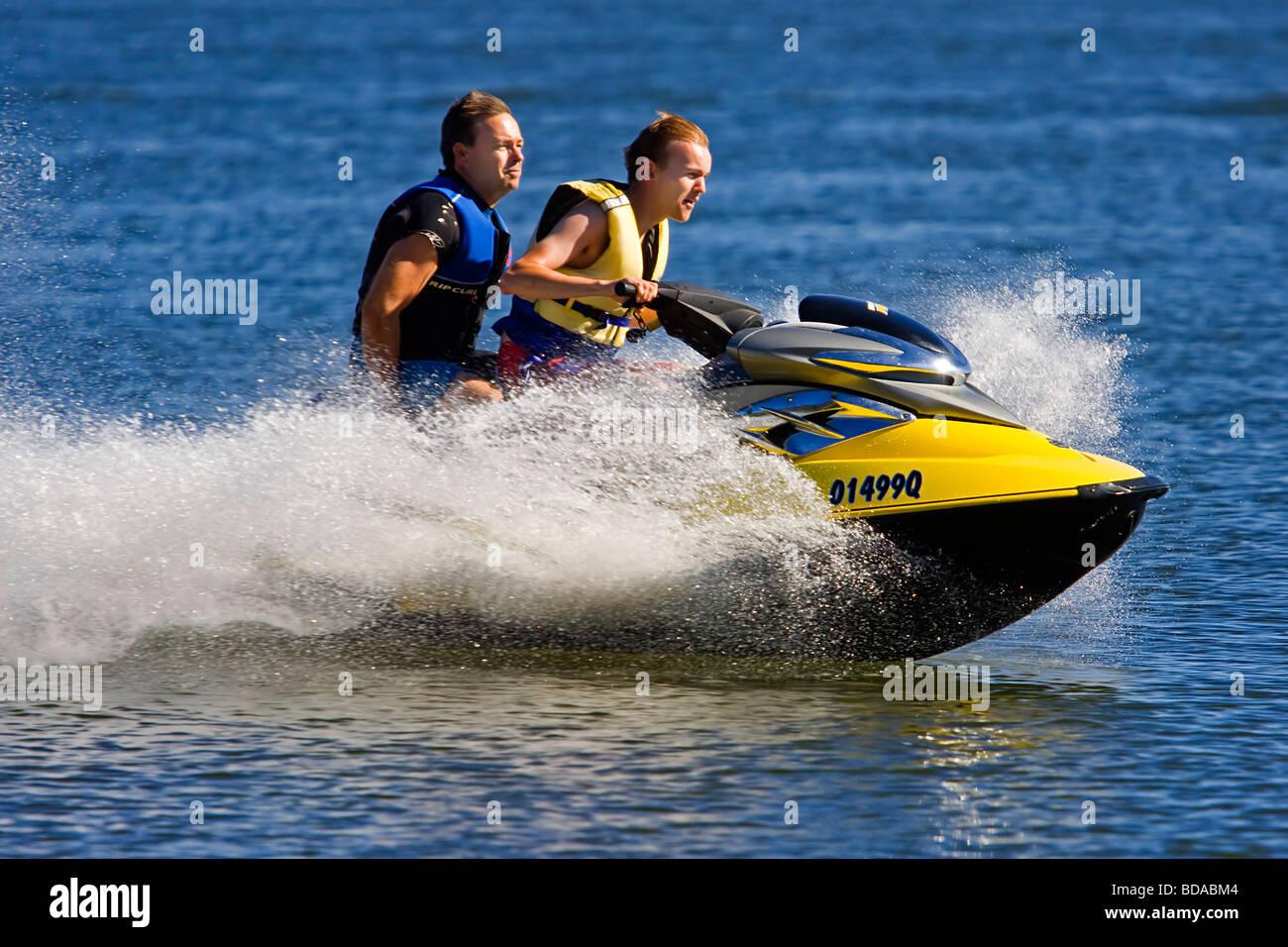 Jetski riders riding leisure sport activity water - Stock Image