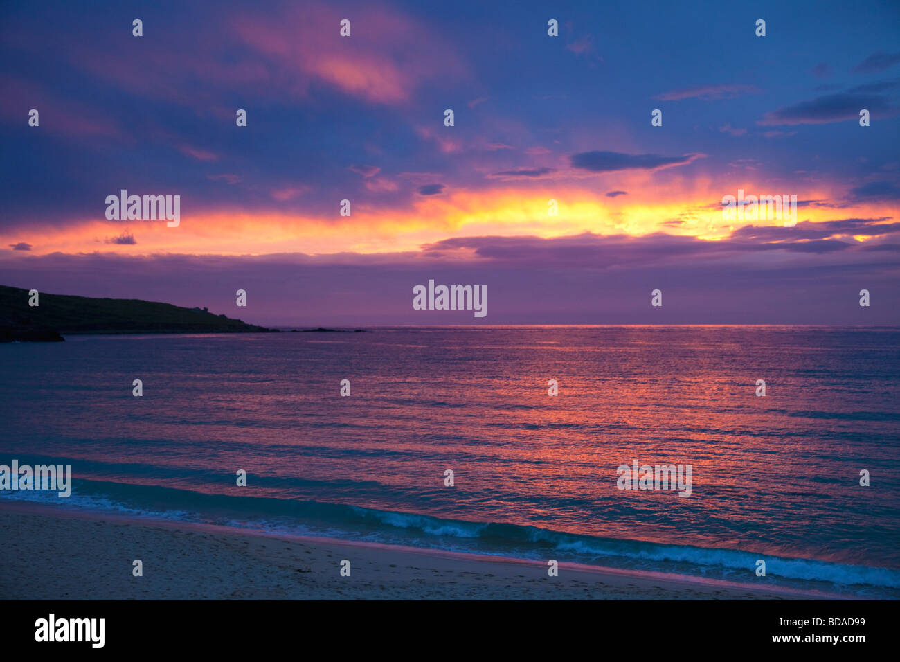 Sunset and clouds over Atlantic Ocean on Porthmeor Beach summer twilight St Ives West Penwith Cornwall England UK - Stock Image