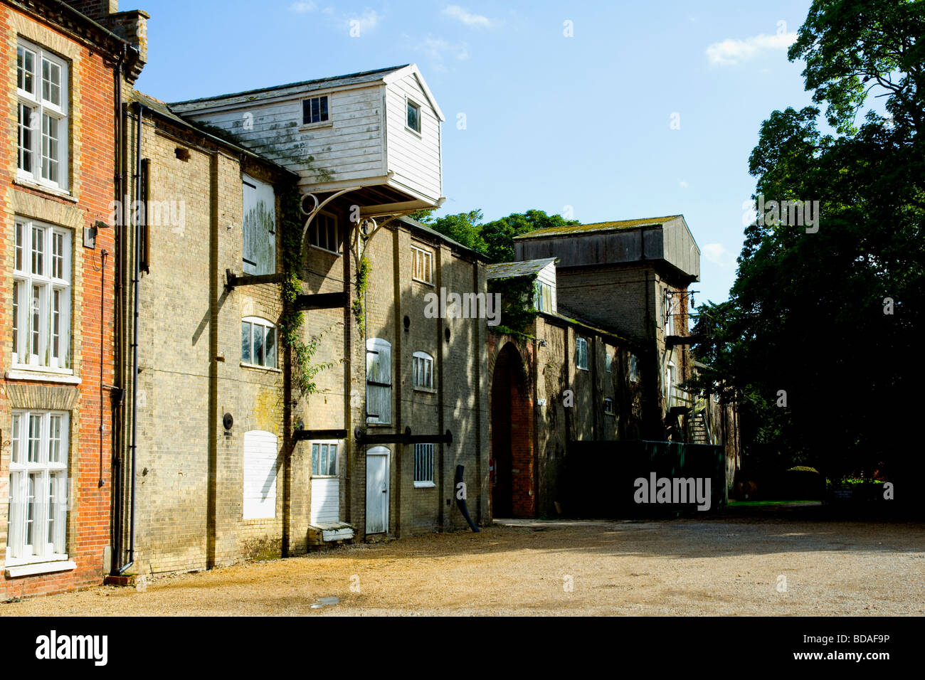 The Maltings at Snape, Suffolk, England.  Derelict warehouses. - Stock Image