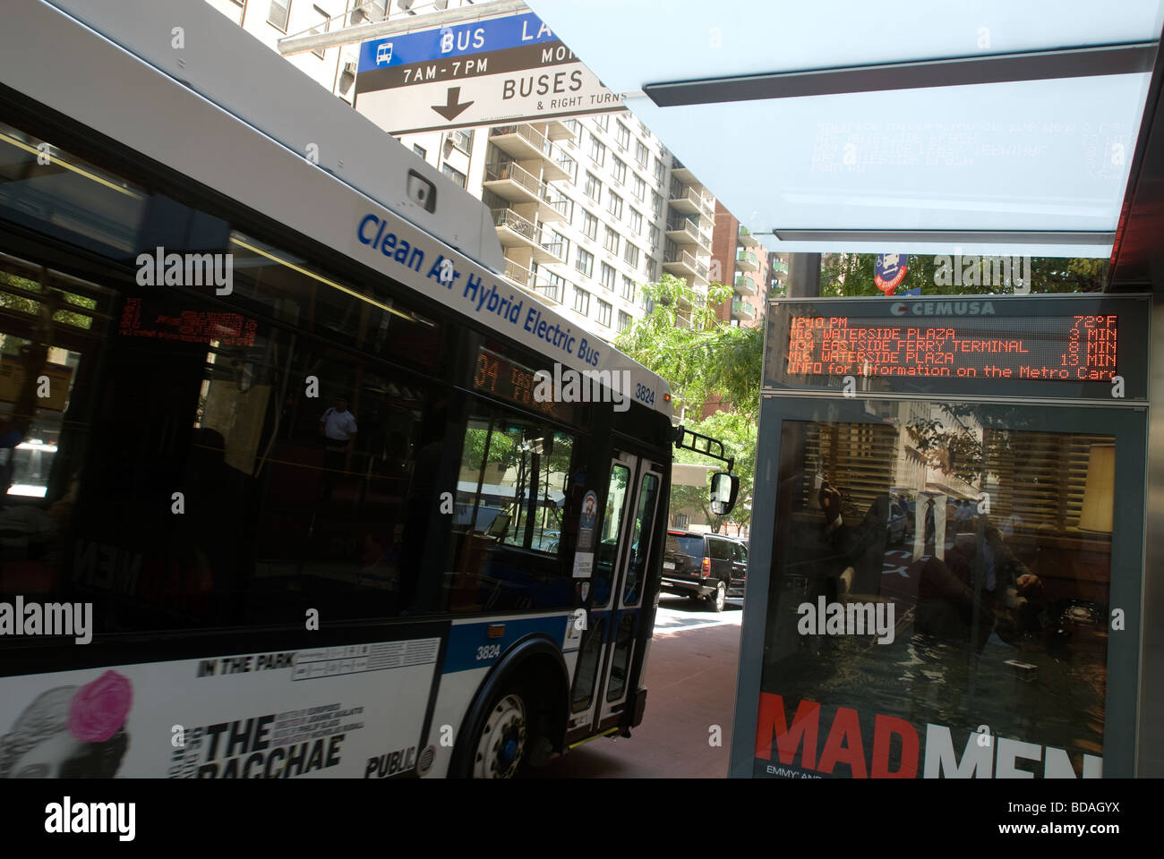New route signs at bus shelters in New York inform commuters of time for bus arrival - Stock Image