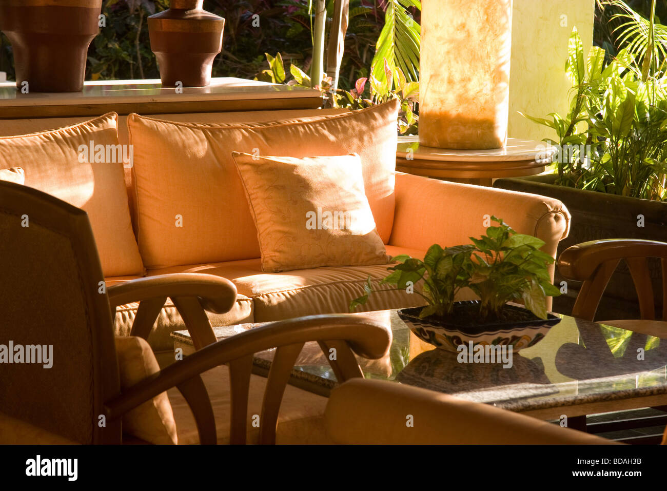 Natural sunlight falls on indoor outdoor patio furniture Stock Photo ...