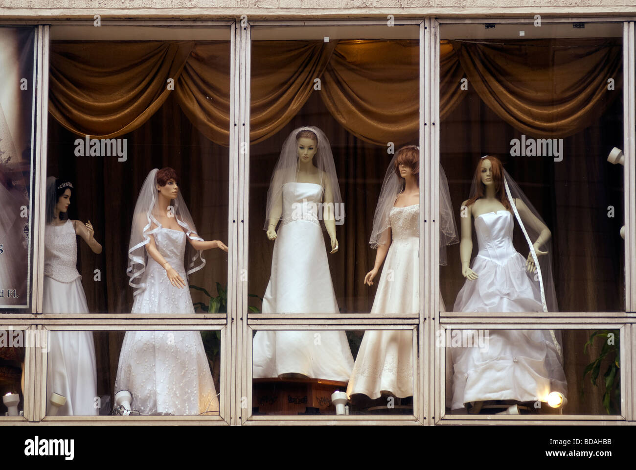 Mannequins displaying wedding dresses in the window of a retailer in ...