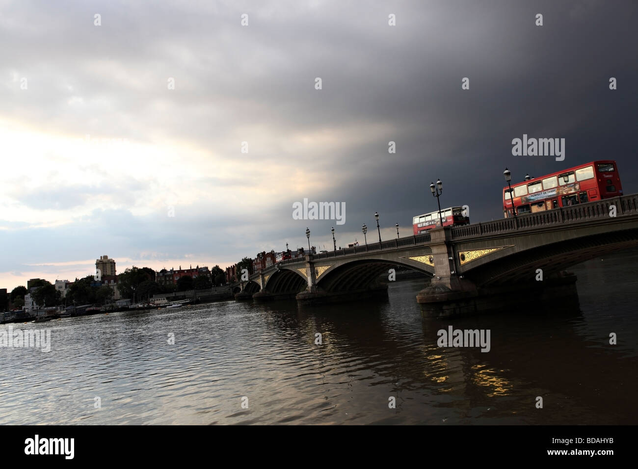 Battersea Bridge photographed during sunset just before a summer storm. - Stock Image