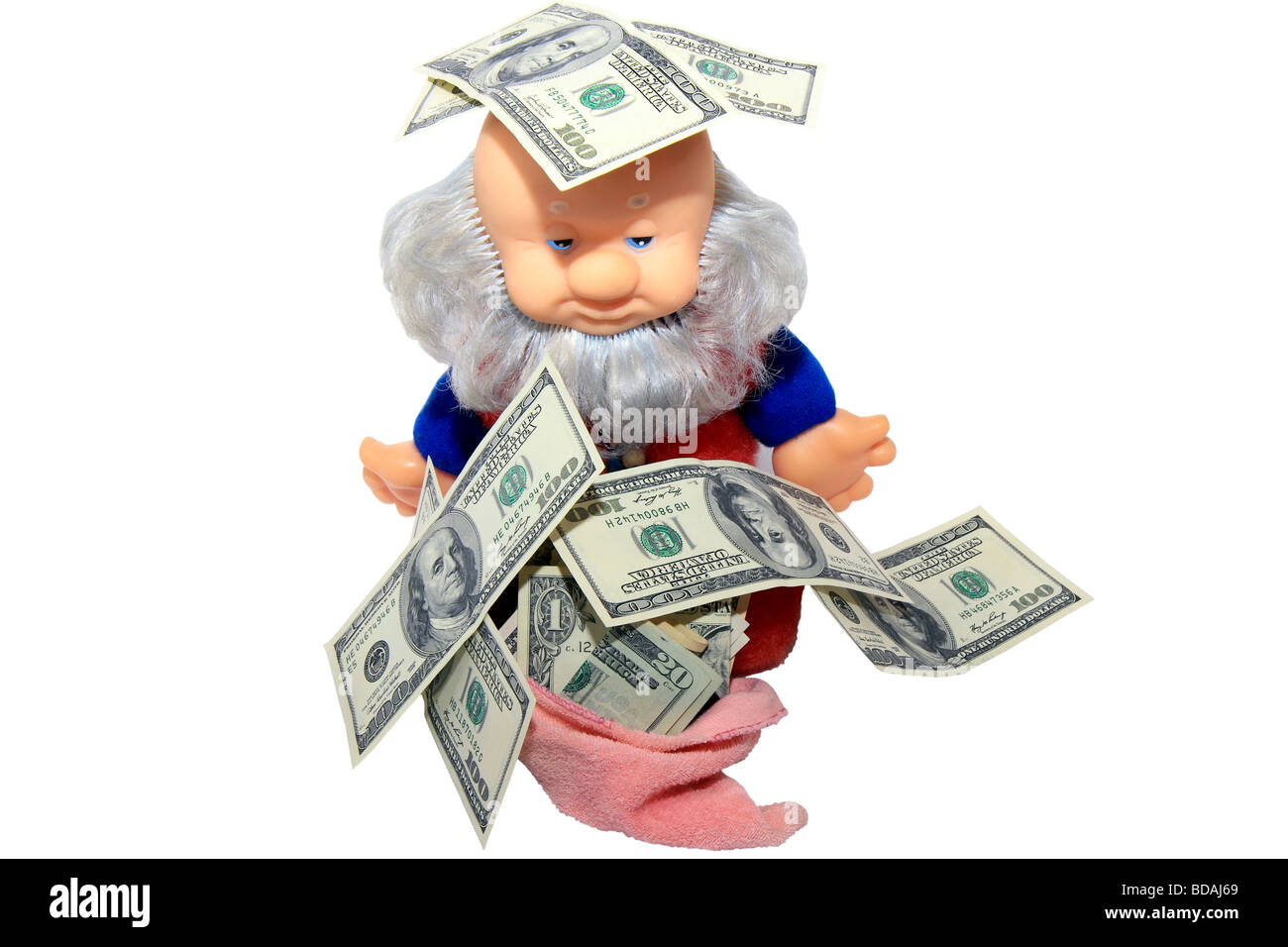 Money fall out on the poor gnome directly from the sky Stock Photo