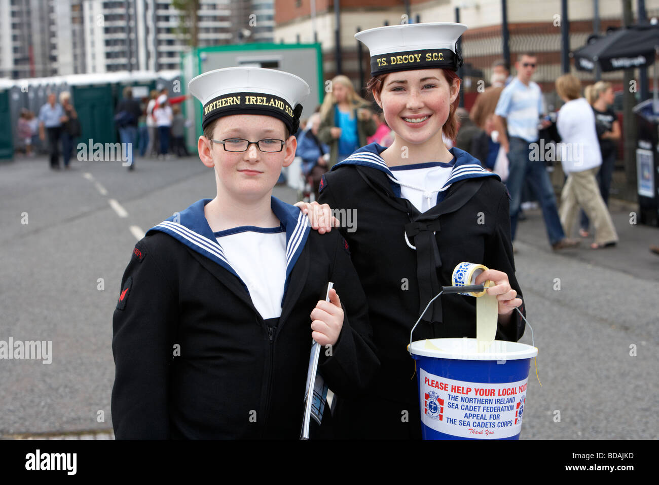 two sea cadets boy and girl raising money for charity at an outdoor event in belfast city northern ireland uk Stock Photo