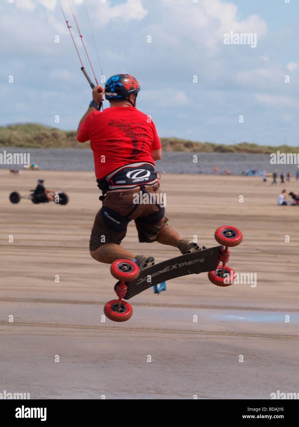 Kite landboarding skateboarding Westward Ho Devon - Stock Image