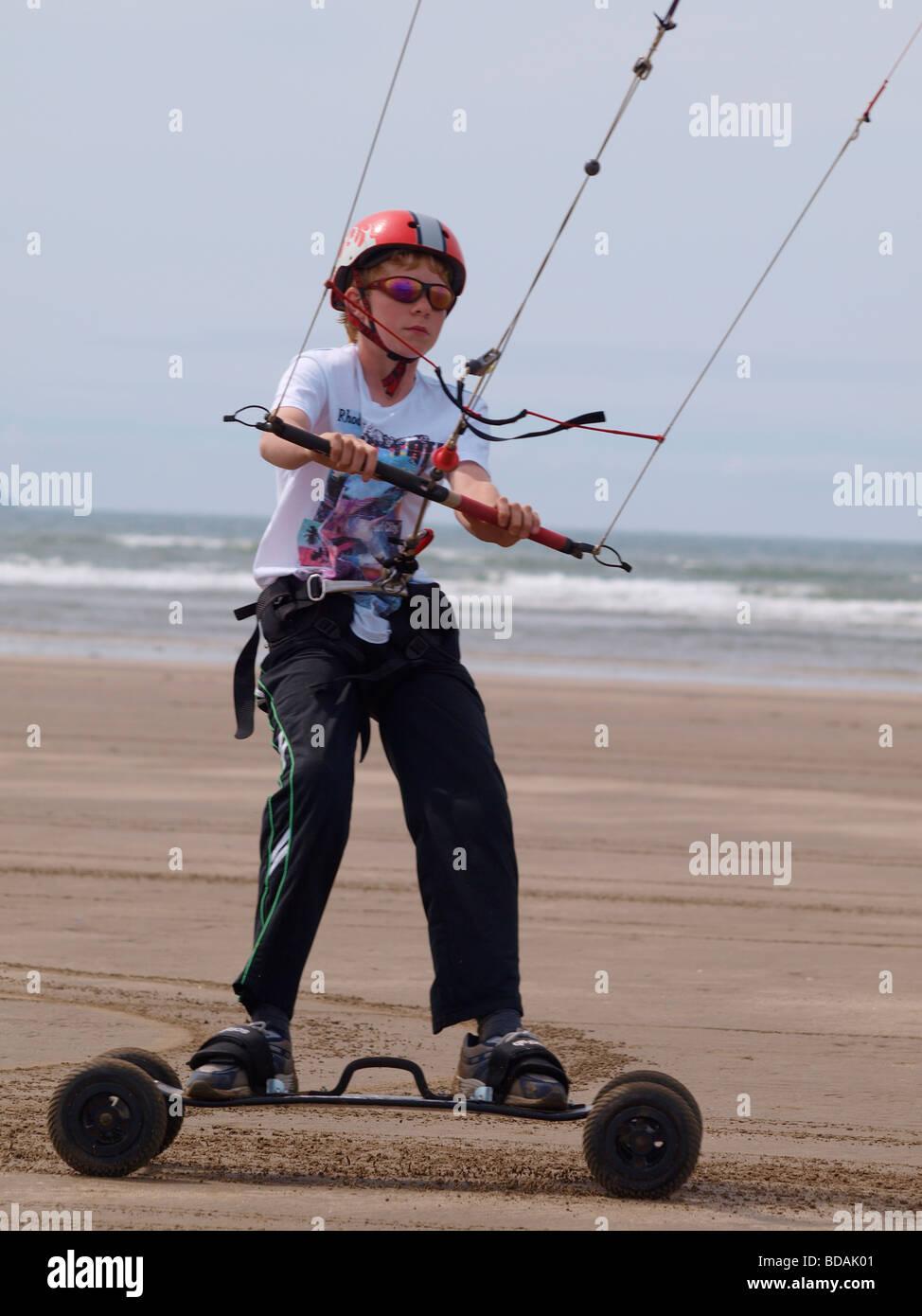 young teenager Kite Landboarding Skateboarding - Stock Image