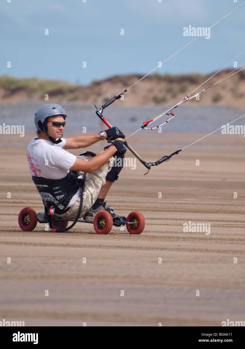 Kite Landboarding Skateboarding at Westward Ho Devon - Stock Image