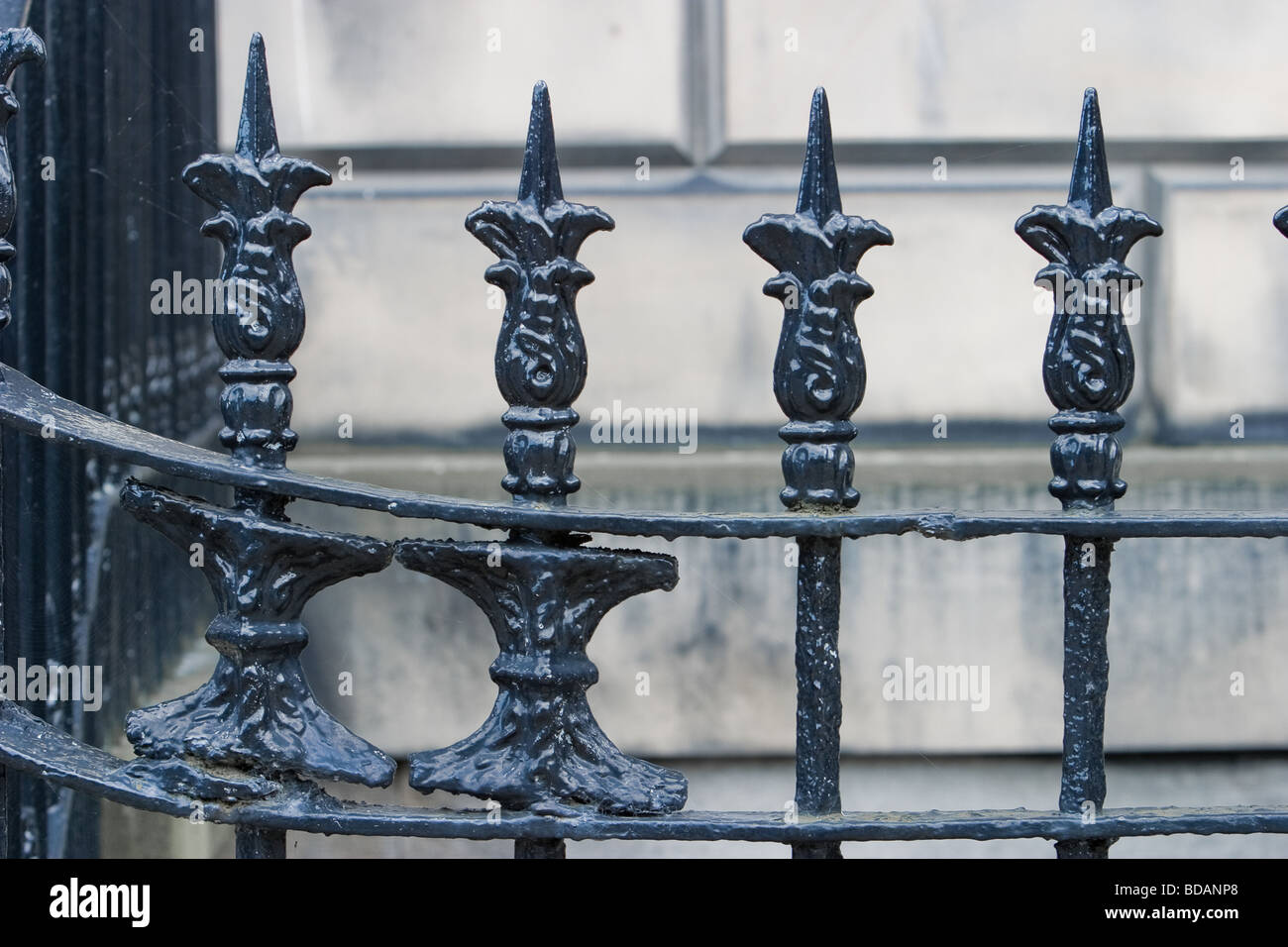 Old cast iron railings in an Edinburgh street - Stock Image