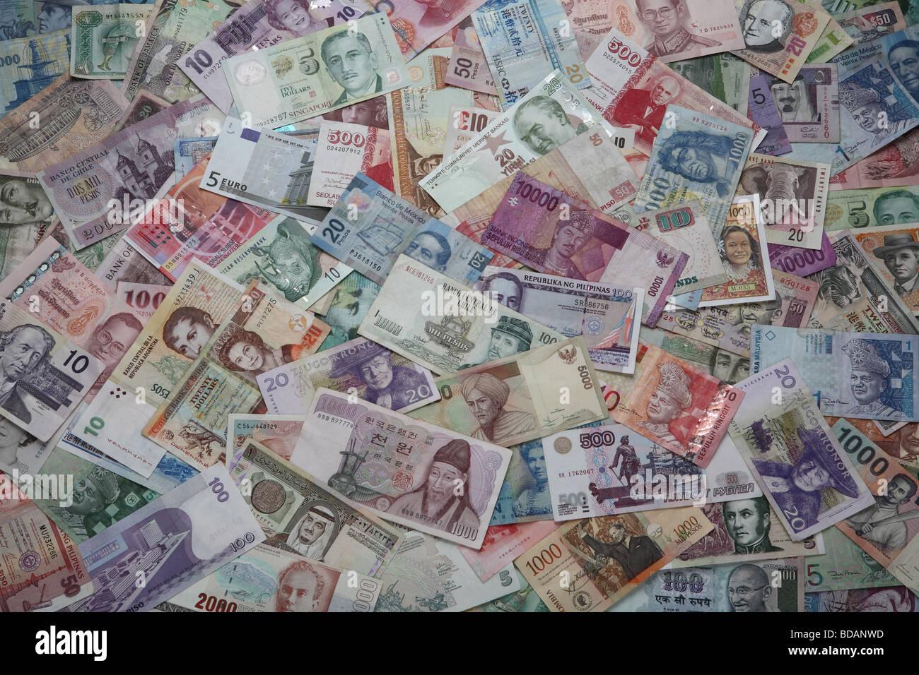 An arrangement of various international currencies. - Stock Image