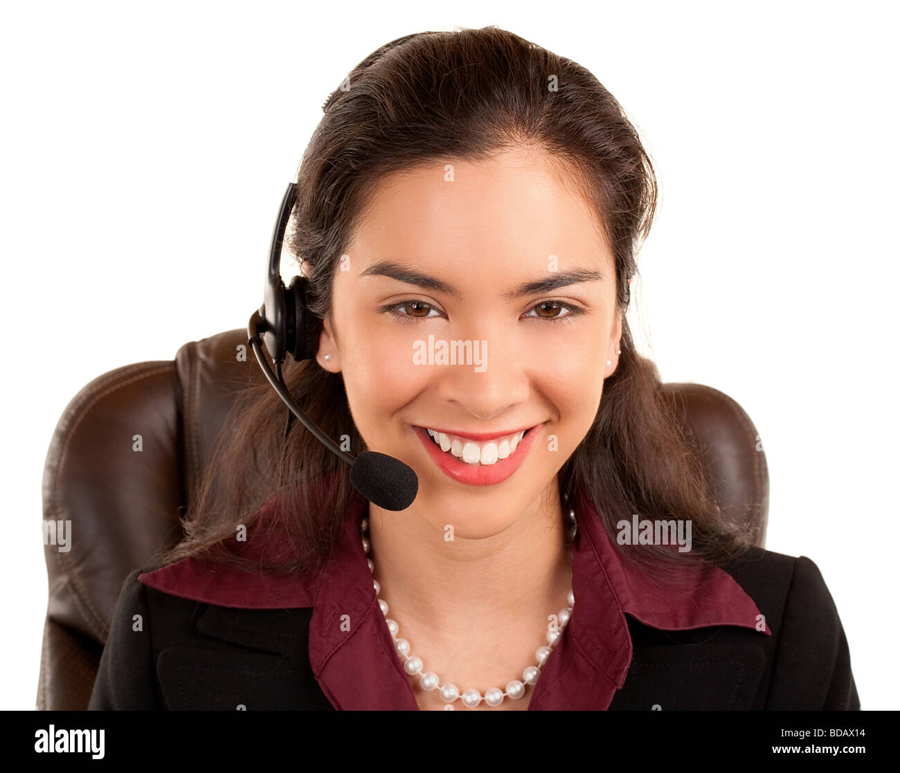 A beautiful smiling woman is wearing a headset Stock Photo