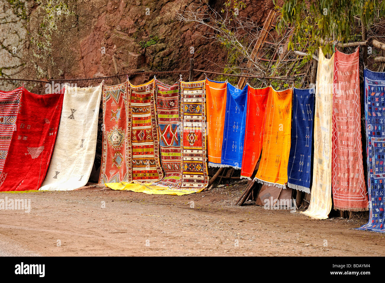 Moroccan carpets for sale on display along the road - Stock Image