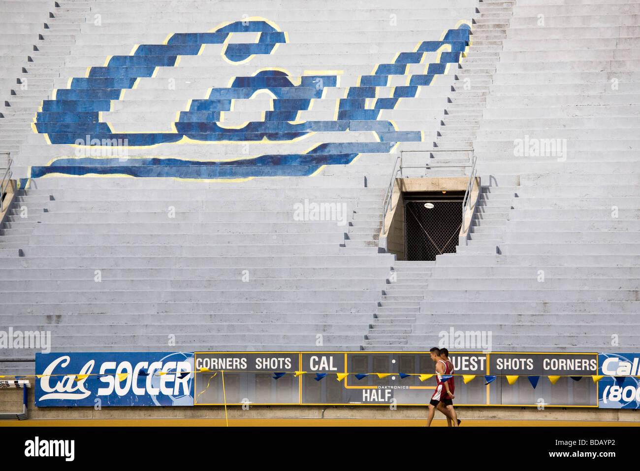 Track competitors walk under the Cal logo at Edwards Stadium at the University of California at Berkeley. - Stock Image