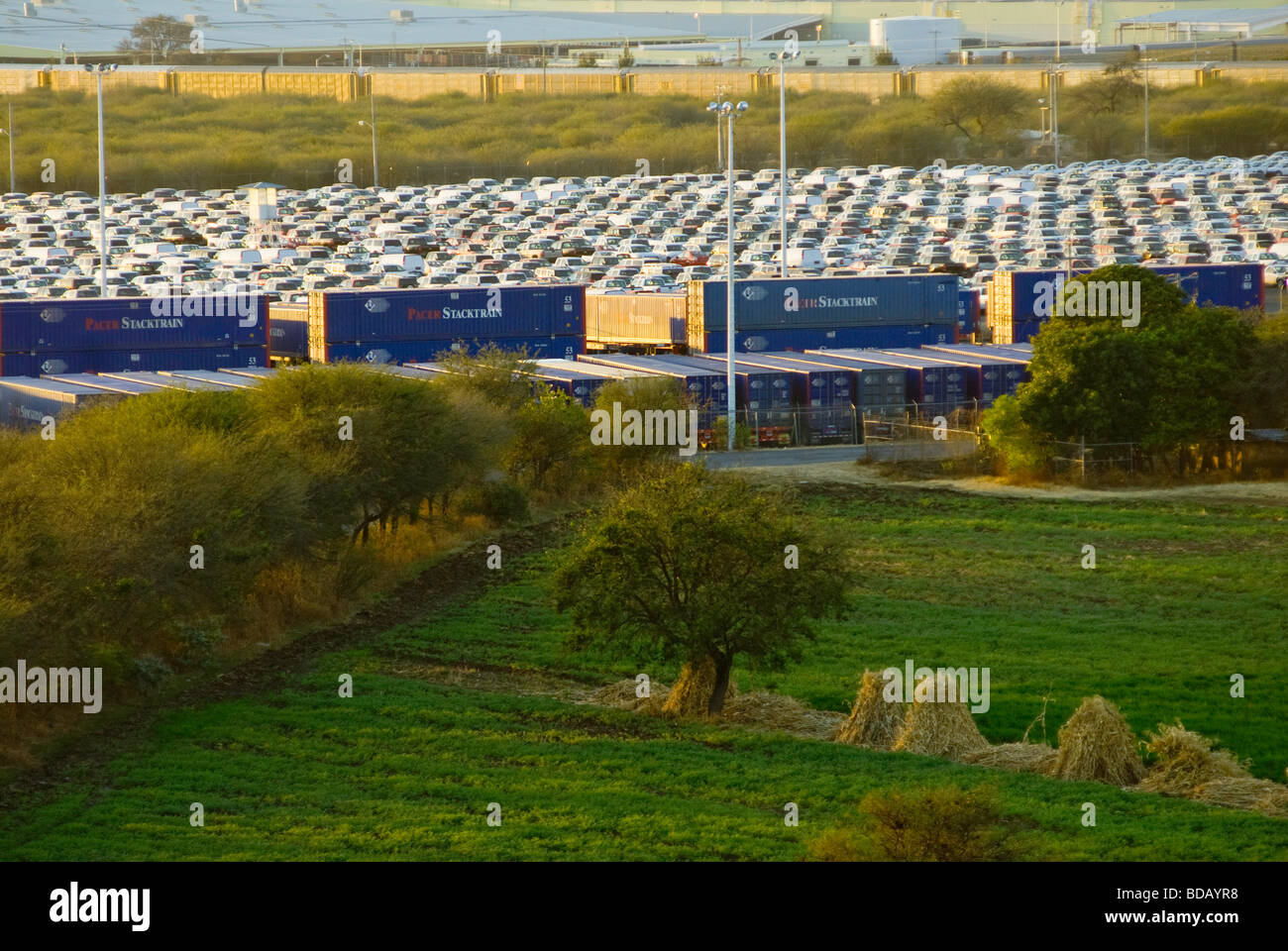 A view of the car and truck holding lot and the buildings of the General Motors plant in Silao Guanajuato from Los Stock Photo