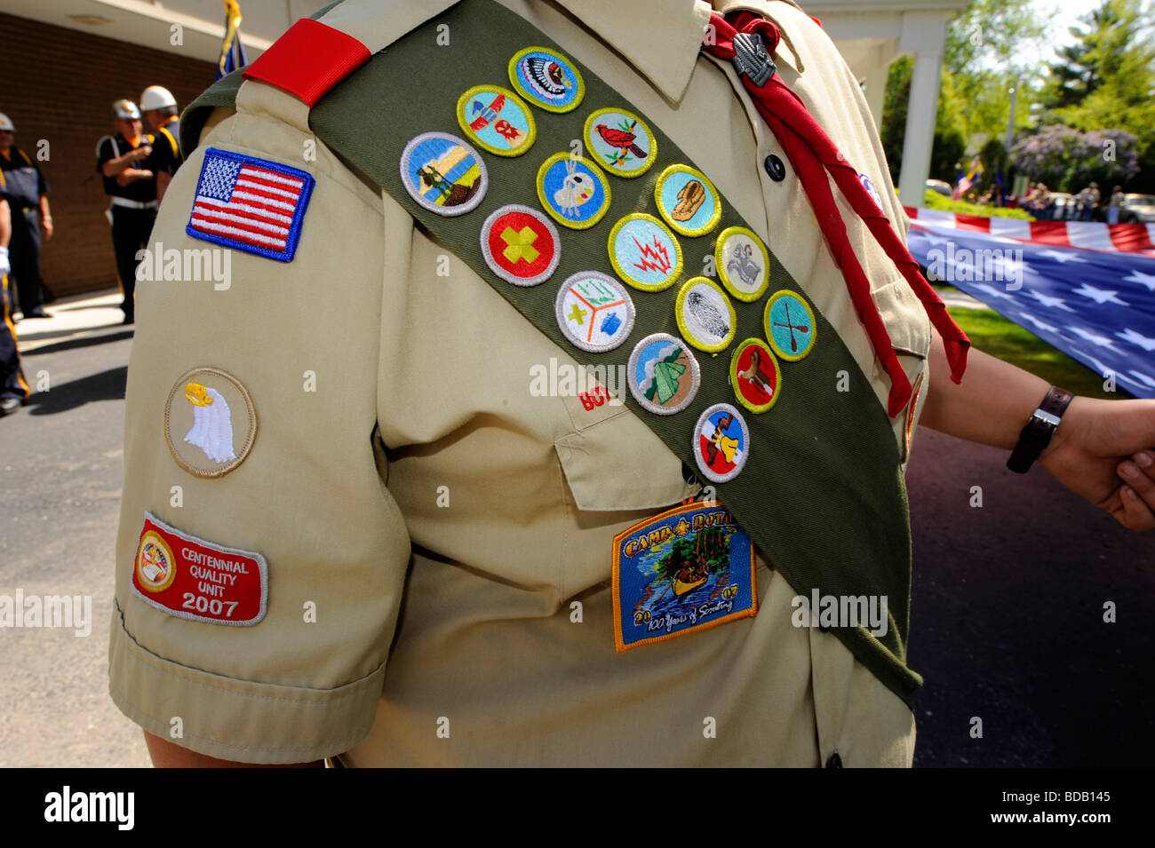 Boy scout in uniform with merit  badges - Stock Image