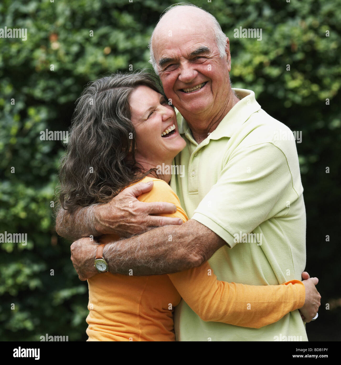 Senior man smiling with her daughter in a park - Stock Image