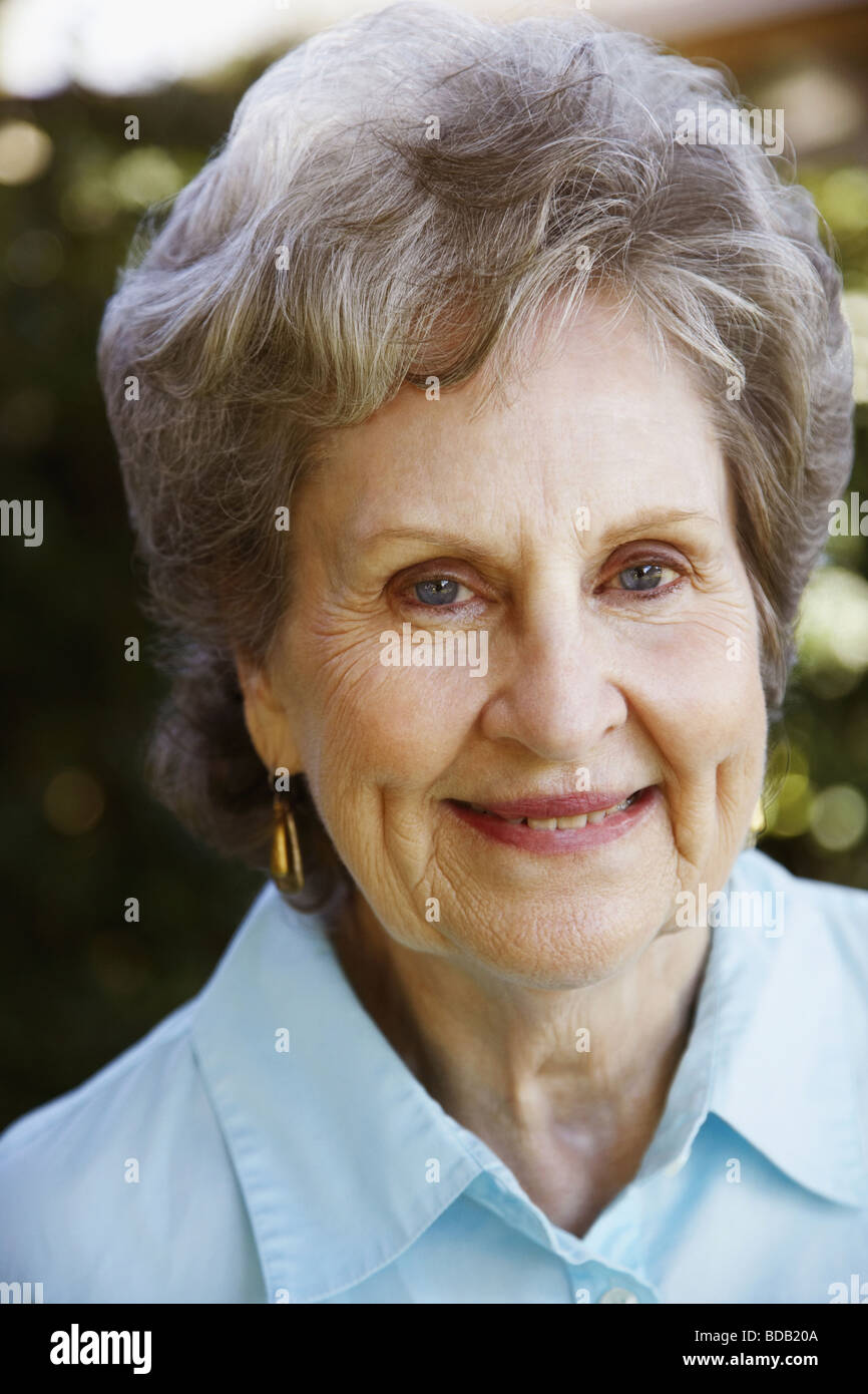 Close-up of a senior woman smiling - Stock Image